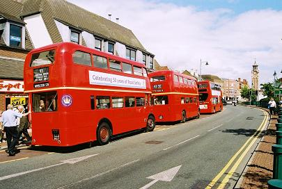 """Fancy seeing a red bus on the 418 ...."""